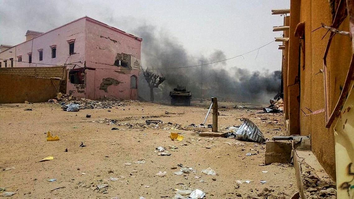 Smoke billows from the site of an explosion in Gao on July 1, 2018, targeting French soldiers operating in northern Mali. (AFP)