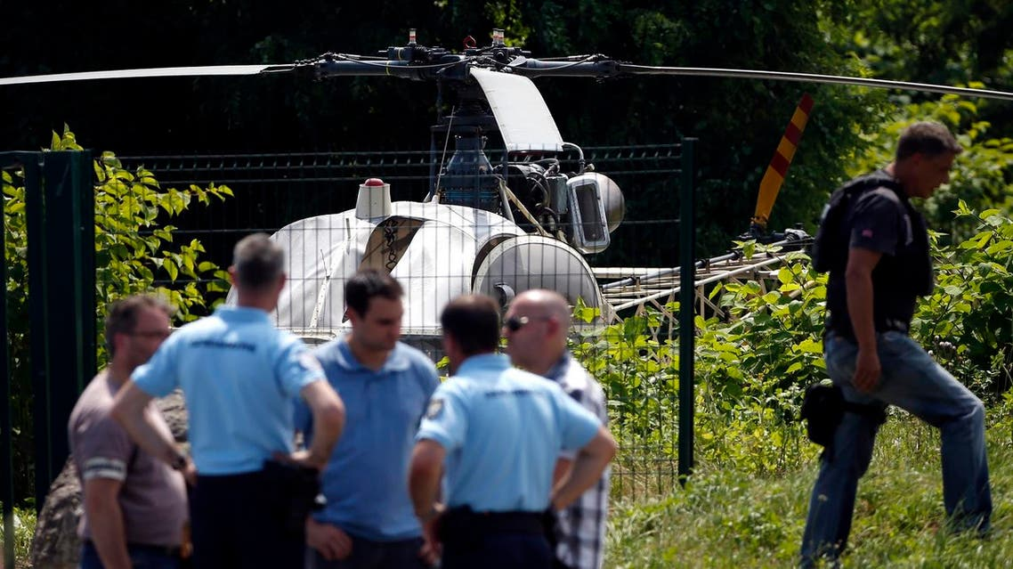 Police near a French helicopter Alouette II abandoned by French armed robber Redoine Faid after his escape from prison in Reau. (AFP)