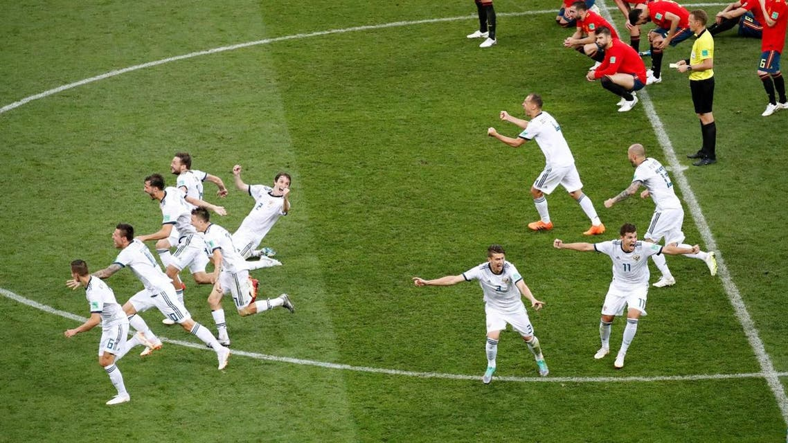 Russia players celebrate winning the penalty shootout. (Reuters)