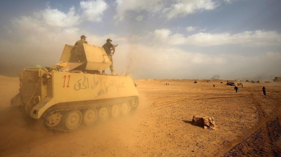 Iraqi forces and members of the PMU militias advance toward the city of al-Qaim, in Iraq's western Anbar province near the Syrian border. (File photo: AFP)