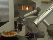 فيديو.. روبوت طباخ يصنع 120 قطعة بيتزا بالساعة الواحدة