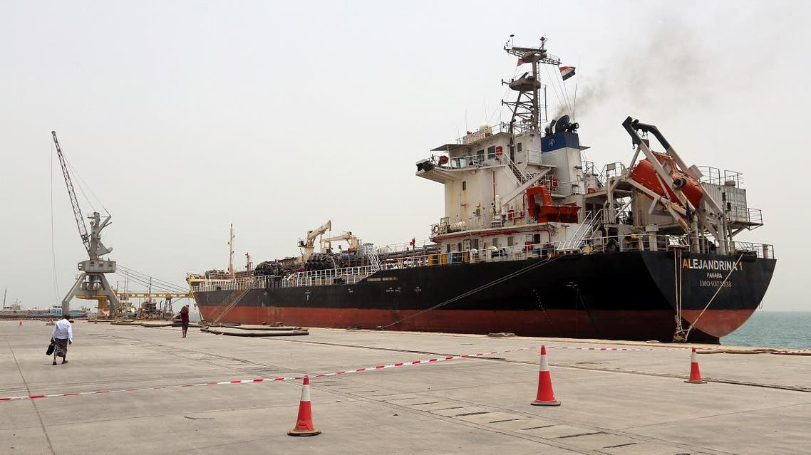A man walks past a ship at the Red Sea port of Hodeidah, Yemen. (Reuters)