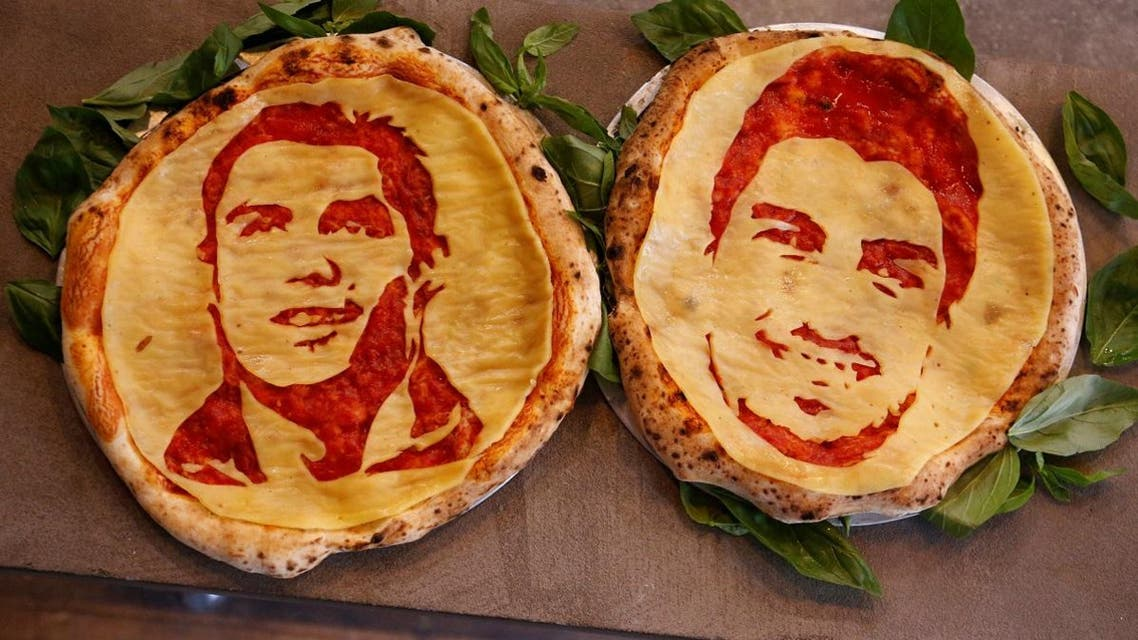 Pizzas decorated with portraits of Portugal's Cristiano Ronaldo and Uruguay's Luis Suarez prepared by cook Valery Maksimchik are displayed at the Hop Head cafe in St. Petersburg. (Reuters)