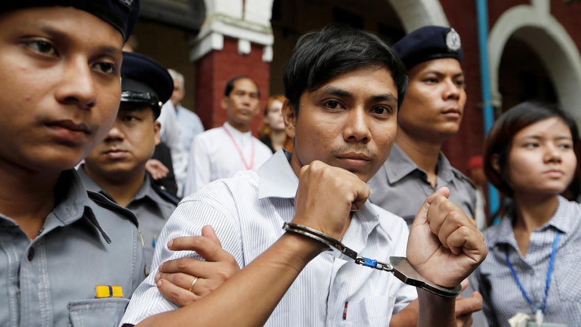 Detained Reuters journalist Kyaw Soe Oo is escorted by police while leaving Insein court in Yangon, Myanmar July 2, 2018. REUTERS