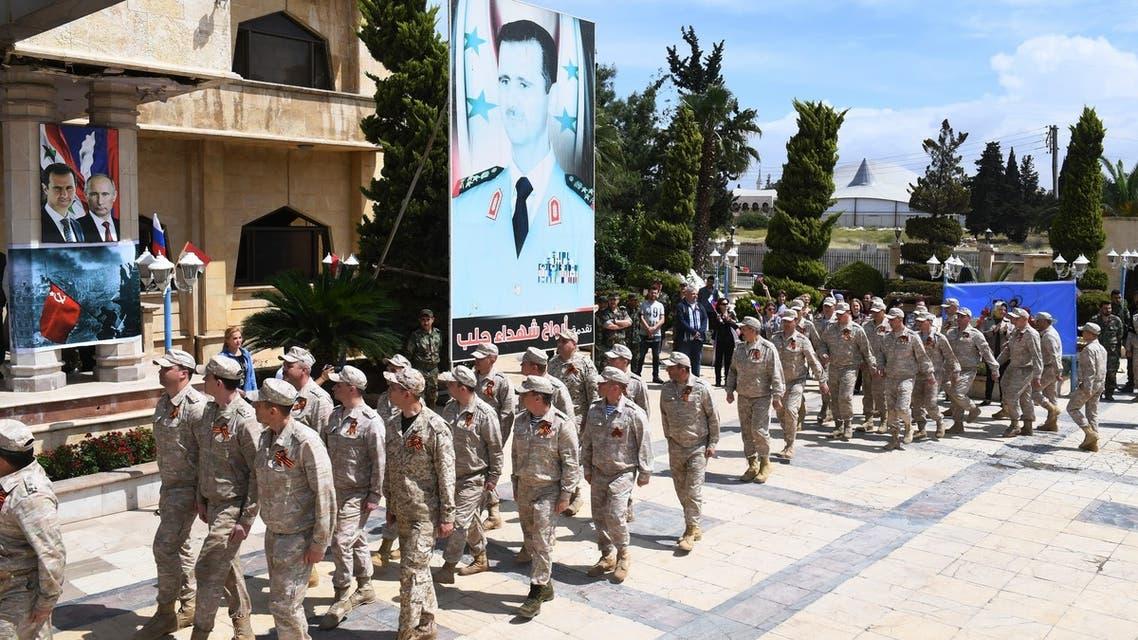 قوات روسية خلال احتفال في حلب