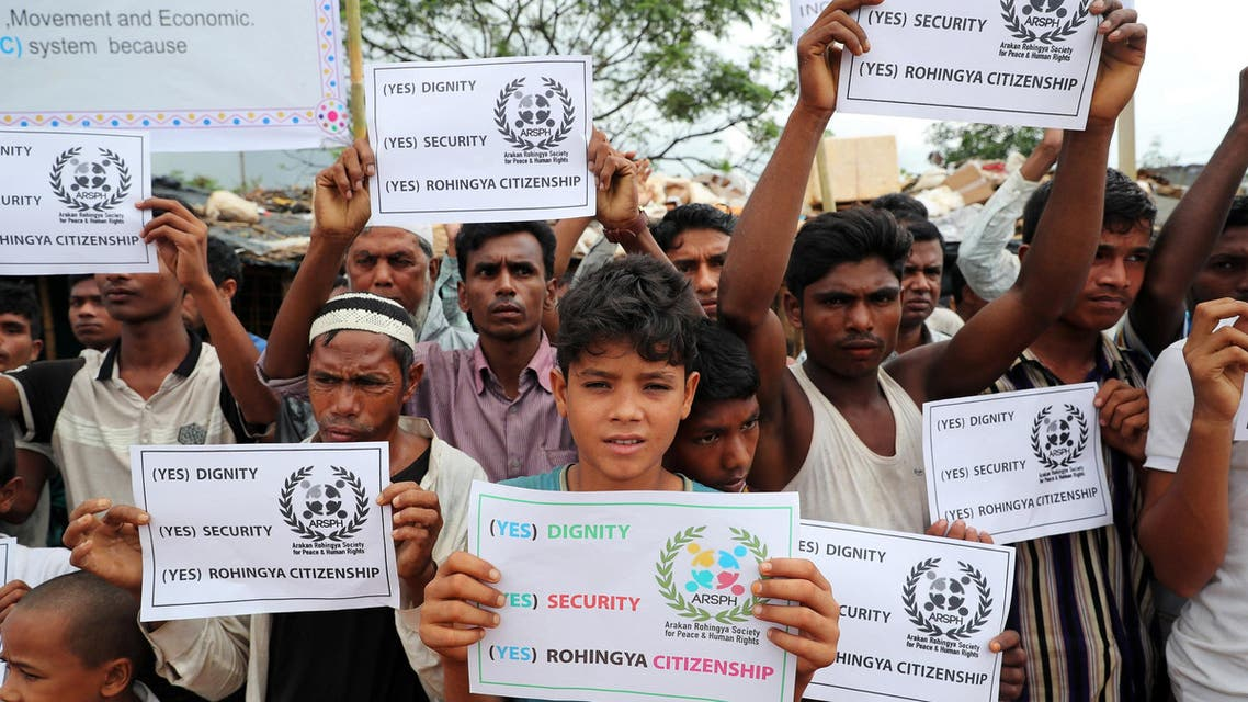 Rohingya refugees hold placards prior to the arrival of UN secretary general Antonio Guterres and World Bank president Jim Yong Kim at the Kutupalong refugee camp in Cox's Bazar, Bangladesh, July 2, 2018. REUTERS