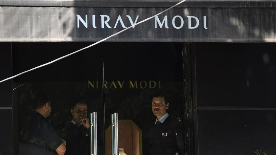 Indian security guards stand at the entrance of a Nirav Modi jewellery showroom in New Delhi on February 15, 2018. Indian investigators on February 15 raided the premises of a billionaire jeweller accused of defrauding one of the country's biggest banks. Enforcement Directorate (ED) officers searched the Mumbai offices of Nirav Modi after he was accused of cheating state-owned Punjab National Bank (PNB) of 2.8 billion rupees ($43.8 million).