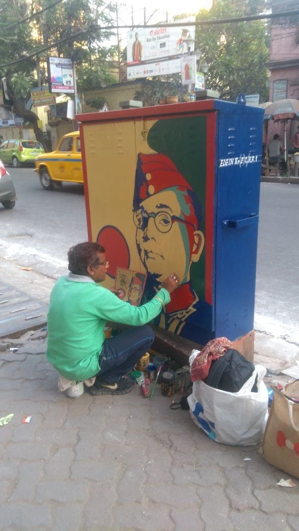 Artists painting a portrait of freedom fighter Subhash Chandra Bose who befriended Germany to drive out the British from India. (Supplied)