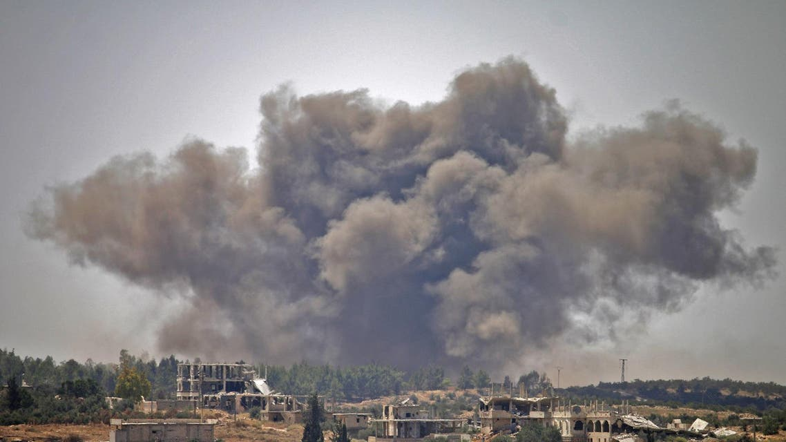 Smoke rises above opposition held areas of the city of Daraa during airstrikes by Syrian regime forces on June 28, 2018. (AFP)