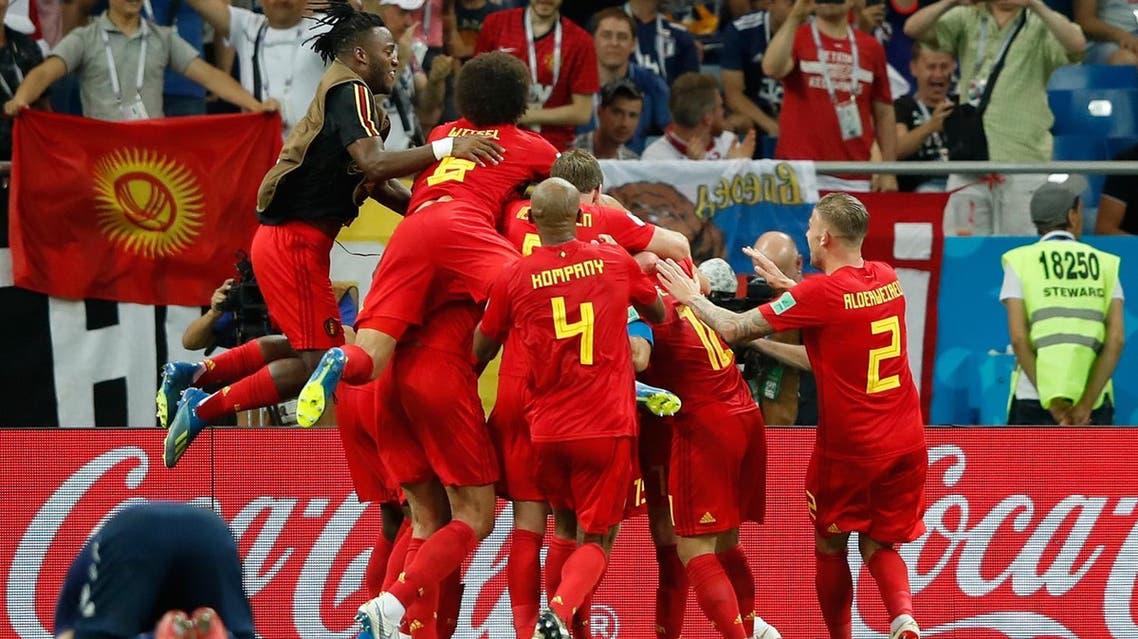Belgium's midfielder Nacer Chadli (hidden) celebrates with teammates after scoring in Rostov-On-Don on July 2, 2018. (AFP)