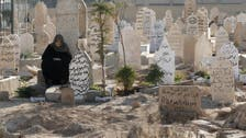Syrians excavating mass graves in Raqqa