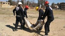 بالفيديو.. فتح مقابر في الرقة وبحث عن هوية آلاف الجثث