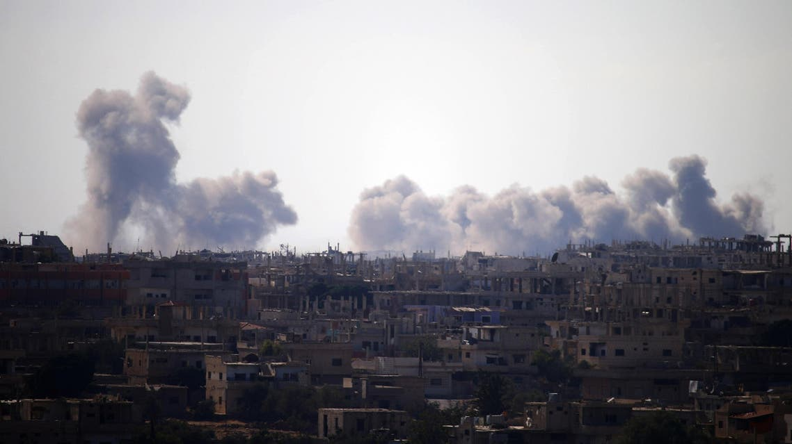 Smoke rises above rebel-held areas of the city of Daraa during airstrikes by Syrian regime forces on June 30, 2018. (AFP)