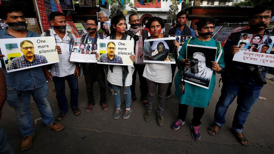 """Journalists hold placards during a silent protest against the killing of Syed Shujaat Bukhari, the editor-in-chief of local newspaper """"Rising Kashmir"""", who according to local media was killed by unidentified gunmen outside his office in Srinagar. (Reuters)"""
