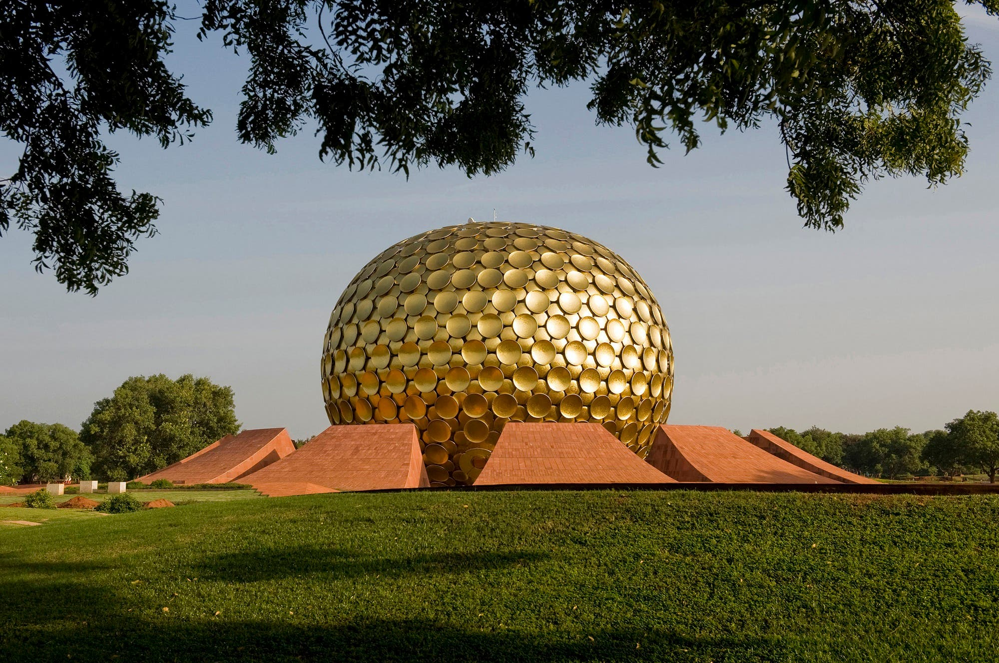 The golden dome-shaped Matrimandir at 'The City of Dawn'. (Supplied)
