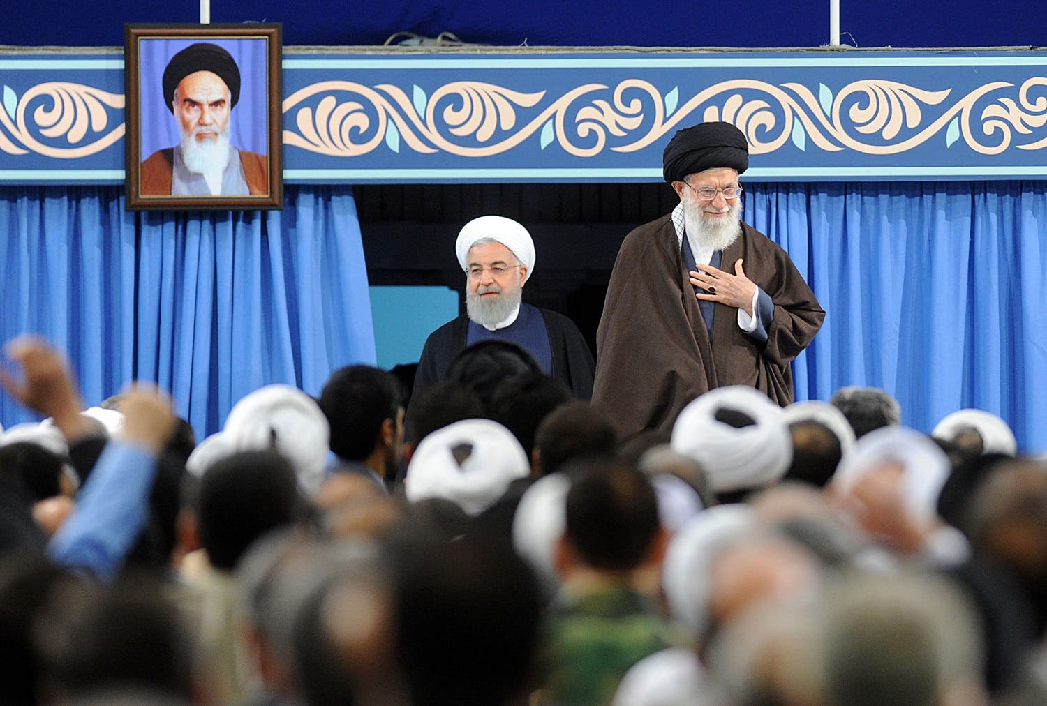Iran's Supreme Leader Ayatollah Ali Khamenei and President Hasan Rouhani (L) arriving for a ceremony in Tehran on April 14, 2018. (AFP)