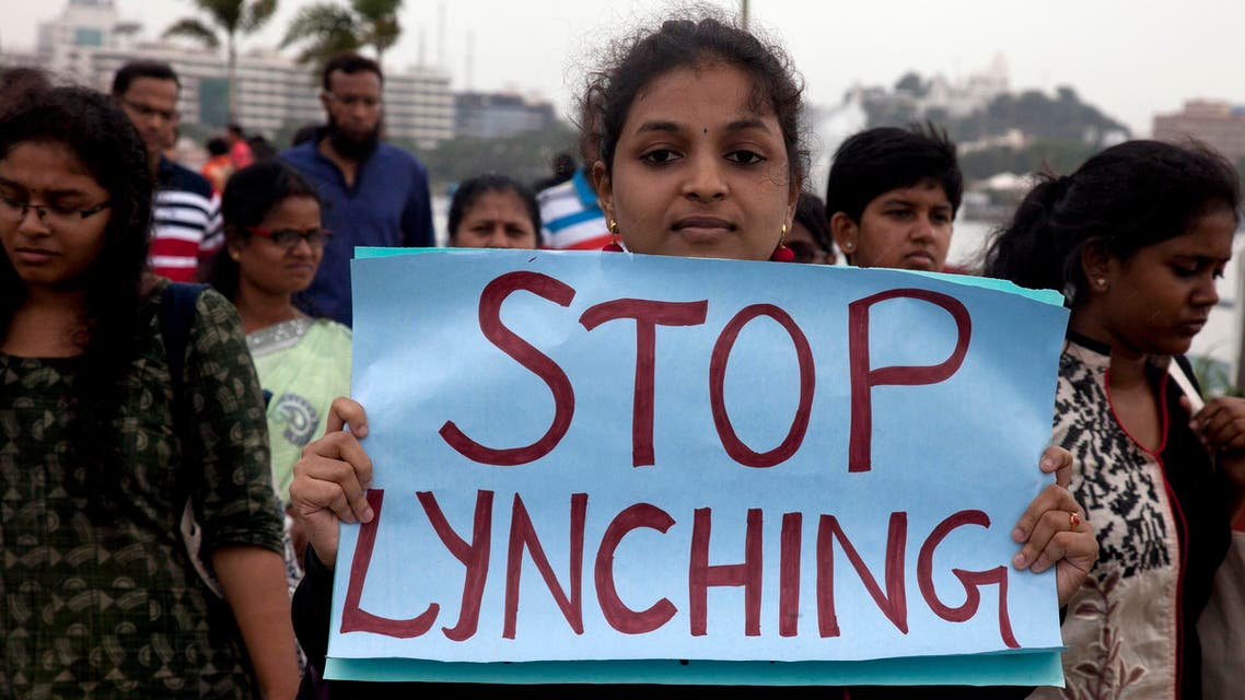 A woman holds a placard, in Hyderabad, on June 28, 2017, during a march against violent attacks across the country targeting the Muslim minority. (AP)