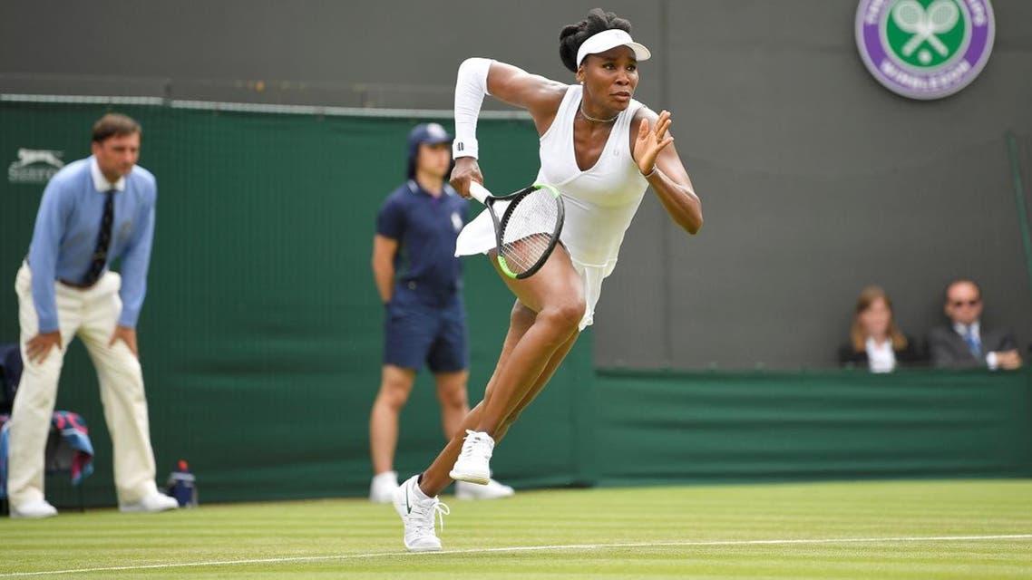Venus Williams of the US runs during her second round match against Romania's Alexandra Dulgheru. (Reuters)