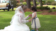 WATCH: 3-year-old cancer survivor at bone marrow donor's wedding as flower girl