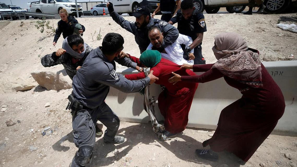 Israeli policemen try to detain Palestinians in the Bedouin village of al-Khan al-Ahmar near Jericho in the occupied West Bank. (Reuters)
