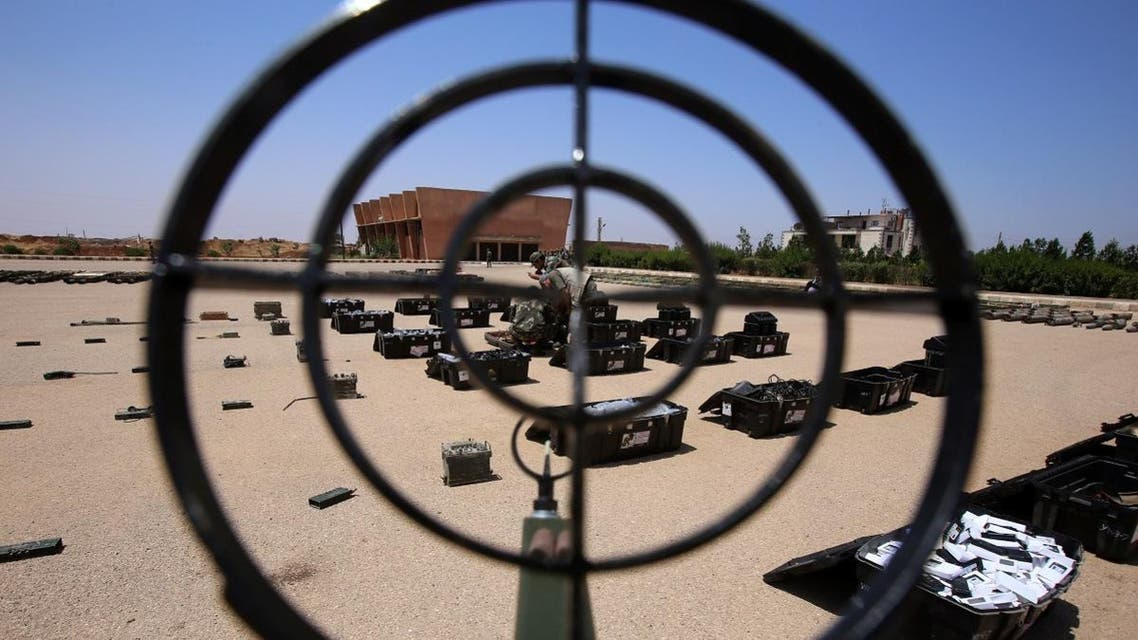 Syrian government forces' soldiers display weapons confiscated from the rebels in a Syrian army military base in the town of Ezraa, province of Daraa, on July 4. (AFP)
