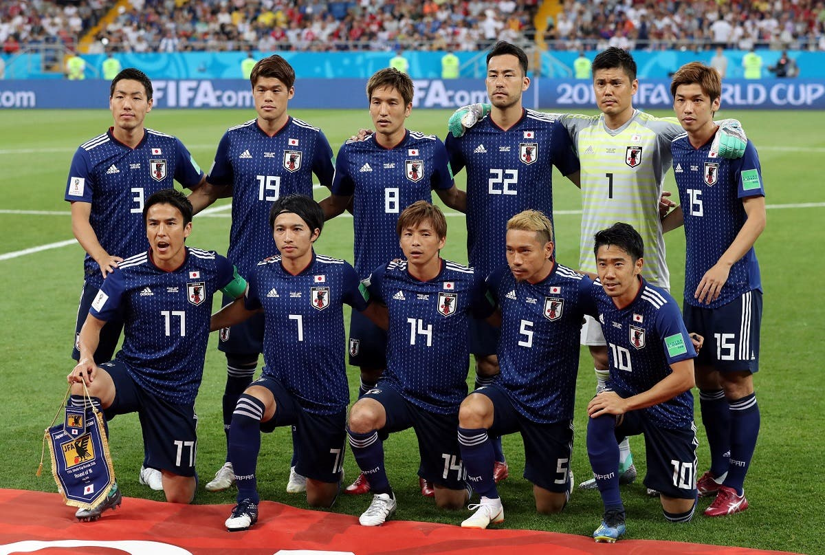 Japan players pose for a team group photo before the match. (Reuters)