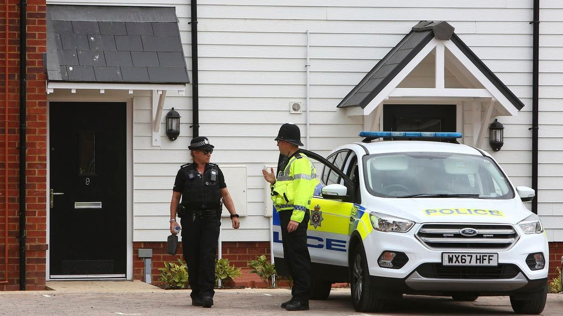 Police officers outside a residential address in Amesbury, southern England, on July 4, 2018 where police reported a man and woman were found unconscious. (AFP)
