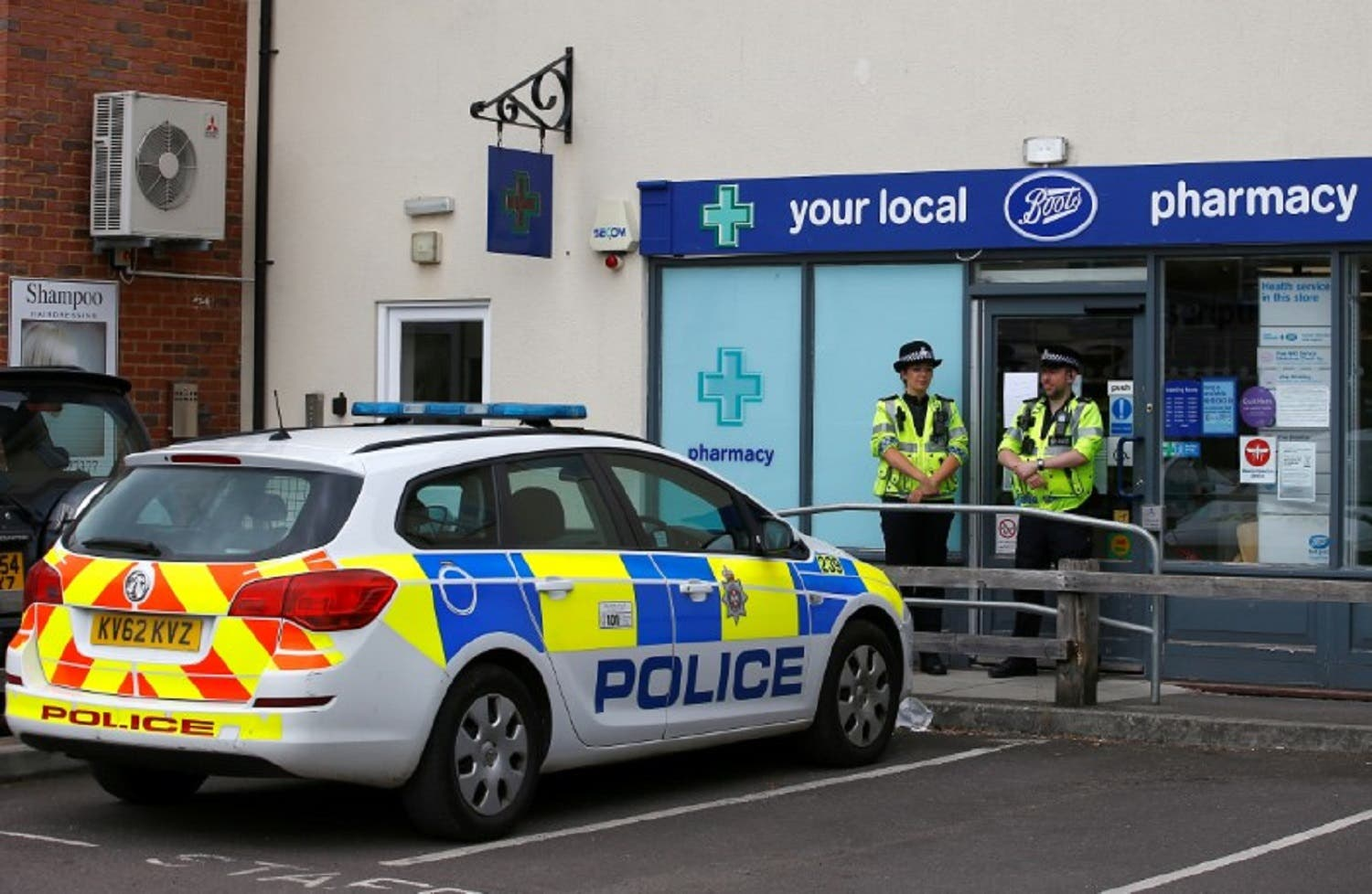 Police officers outside a pharmacy branch which was cordoned off after the poisoning of two people in Amesbury, in the UK. (Reuters)