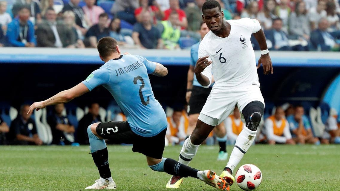 France's Paul Pogba in action with Uruguay's Jose Gimenez in the first World Cup quarter-final on Friday. (Reuters)