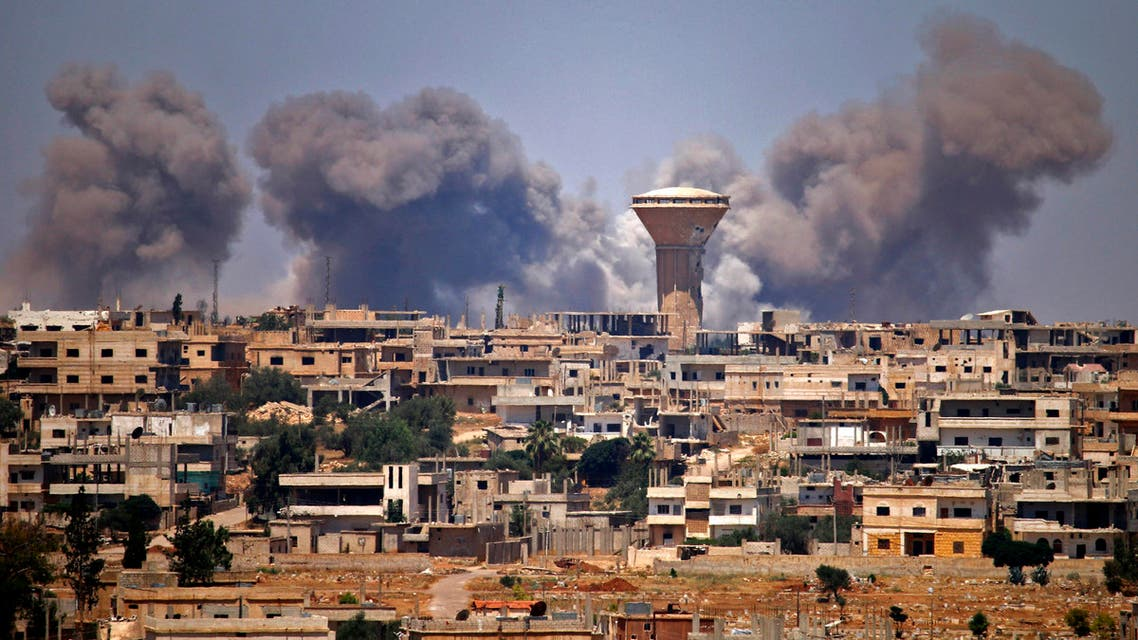 Smoke rises above rebel-held areas of the city of Daraa during reported airstrikes by Syrian regime forces on July 5, 2018. Waves of air strikes pounded rebel-held areas of southern Syria after the failure a day earlier of Russian-brokered talks to end the offensive in Daraa province, which has killed dozens and forced tens of thousands from their homes.