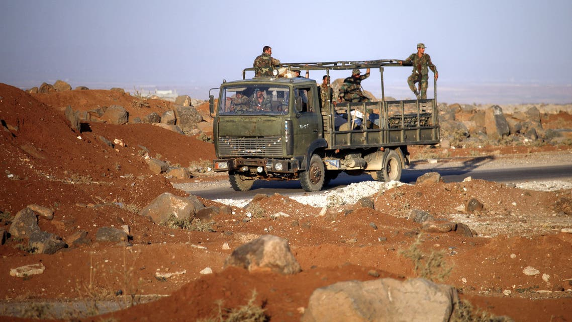 Syrian government soldiers ride in an army truck near the Nassib border crossing with Jordan in the southern province of Daraa on July 6, 2018, after they regained control over it from rebel forces. The Nassib crossing was overrun by rebels in April 2015, sealing off the regime's crucial trade route with neighbouring Jordan, which calls it Jaber. With the crossing's recapture two weeks into a Russian-backed offensive, the government hopes it can reopen the vital trade lifeline.