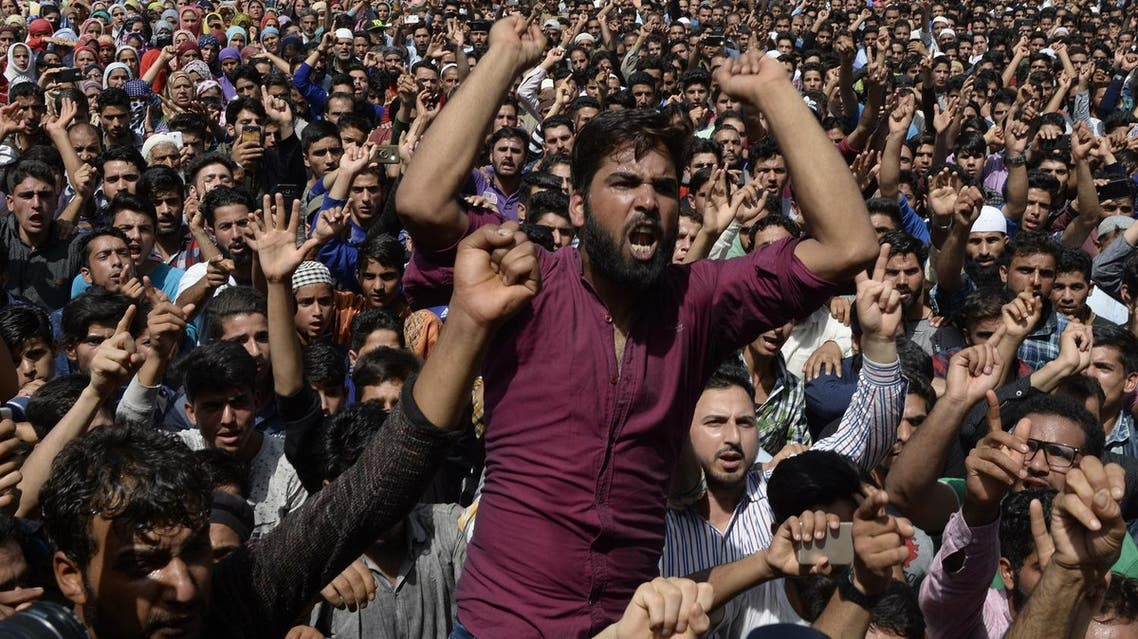 Kashmiri villagers shouts during a funeral procession of a three youths including a teenage girl at Kulgam, south of Srinagar on July 7, 2018. (AFP)