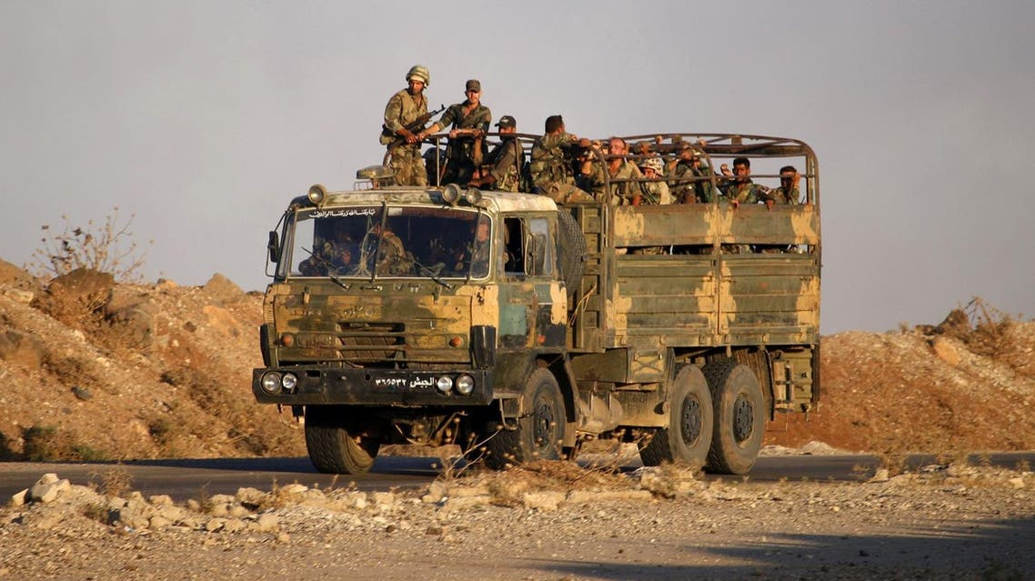 Syrian soldiers ride in an army truck near the Naseeb border crossing with Jordan in the southern province of Daraa on July 6, 2018, after they regained control over it from rebel forces. (AFP)