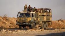 Syrian troops celebrate recapture of border crossing