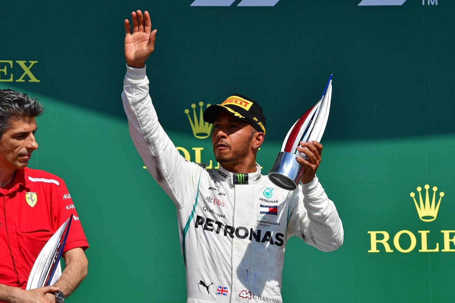Second-placed Mercedes' British driver Lewis Hamilton celebrates with his trophy on the podium after the British Formula One Grand Prix at the Silverstone motor racing circuit in Silverstone, central England, on July 8, 2018. (AFP)