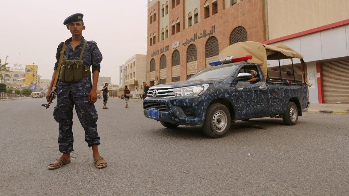 Pro-Houthi police trooper stands past a patrol vehicle in the Red Sea port city of Hodeidah. (File photo: Reuters)