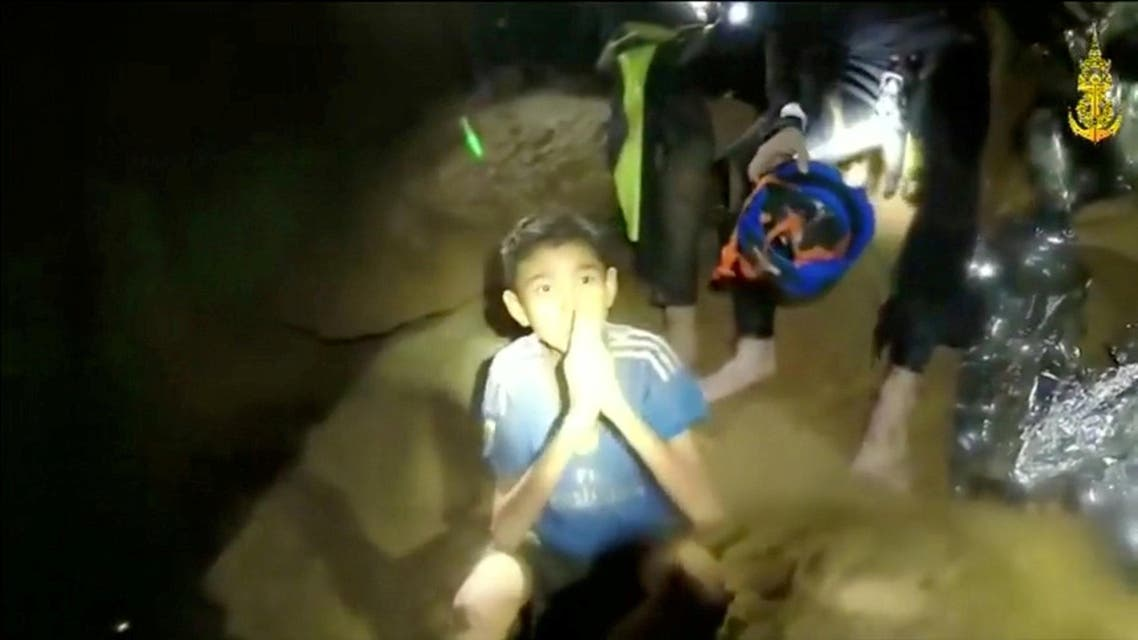 Boys from the under-16 soccer team trapped inside Tham Luang cave greet members of the Thai rescue team in Chiang Rai. (Reuters)