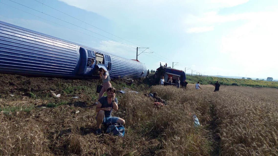 A man uses a mobile phone after a train accident at Corlu district in Tekirdag on July 8, 2018. (AFP)