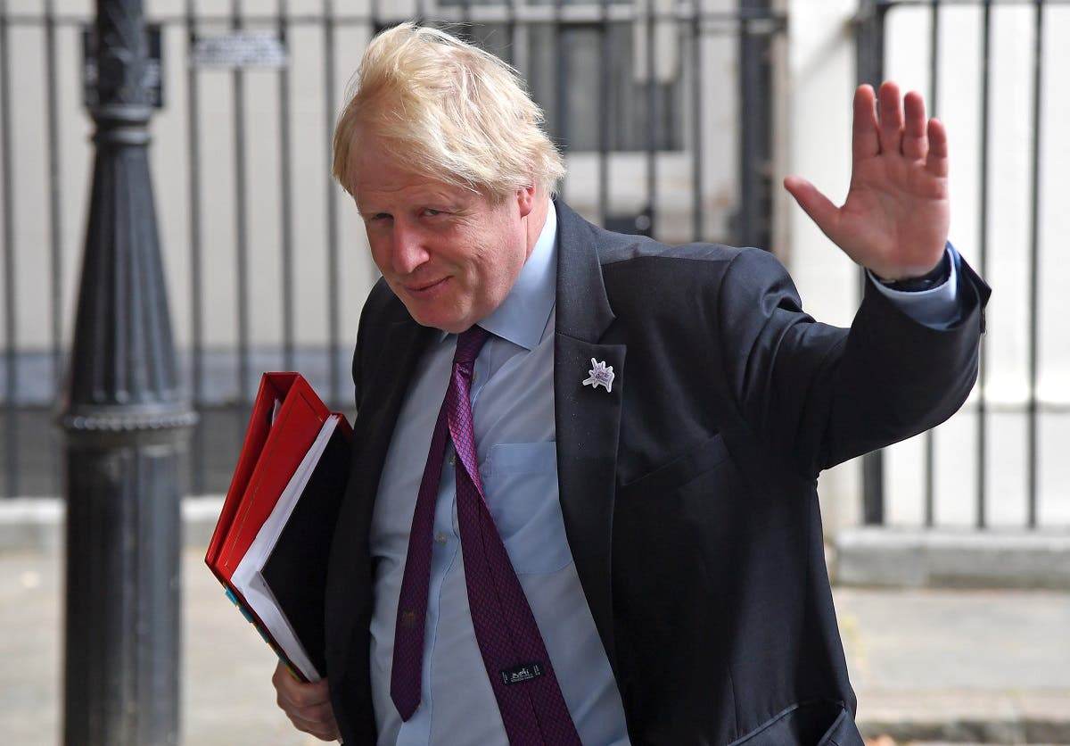 Britain's Foreign Secretary Boris Johnson waves as he leaves Downing Street in London. (Reuters)