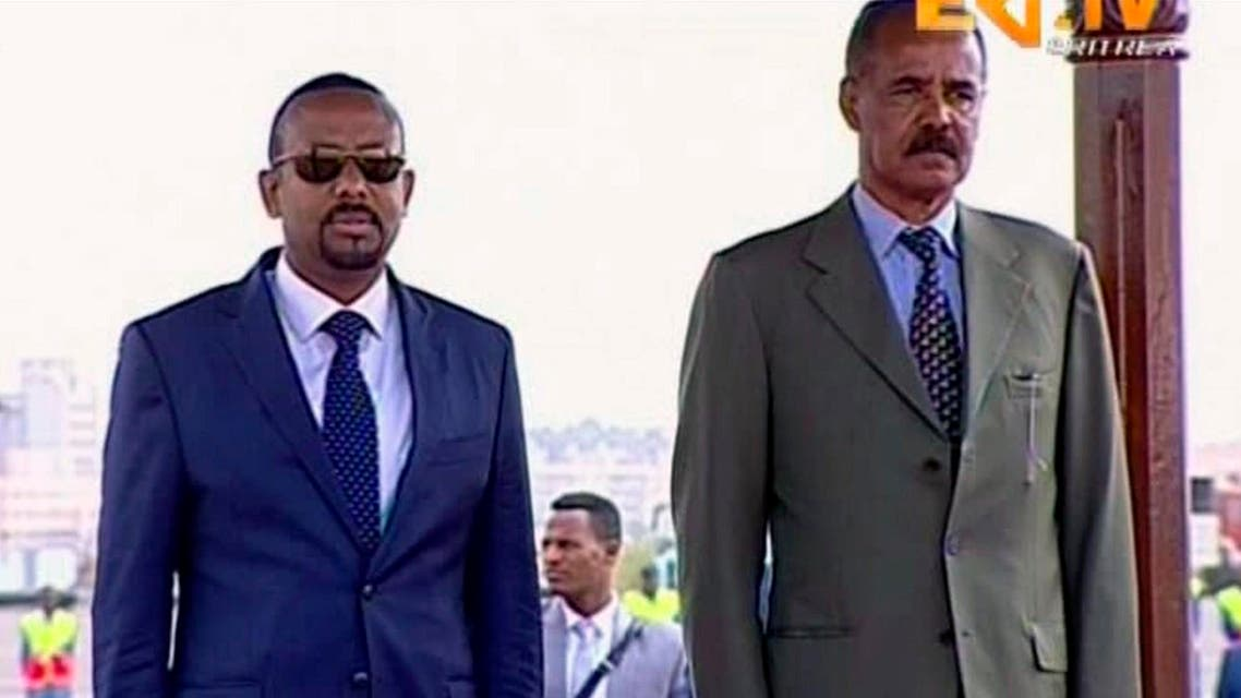 In this grab taken from video provided by ERITV, Ethiopia's Prime Minister Abiy Ahmed, left and Erirea's President Isaias Afwerki observe the Guard or Honour during a welcome ceremony for Ahmed, in Asmara, Eritrea. (AP)