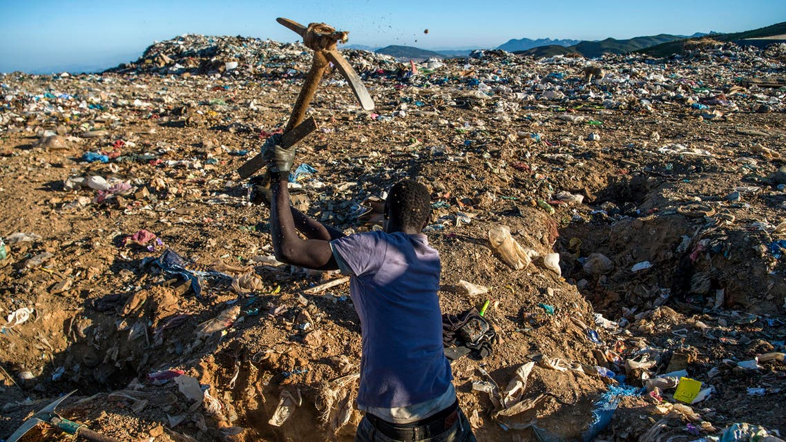migrant looks for food in morroco garbage (AFP)