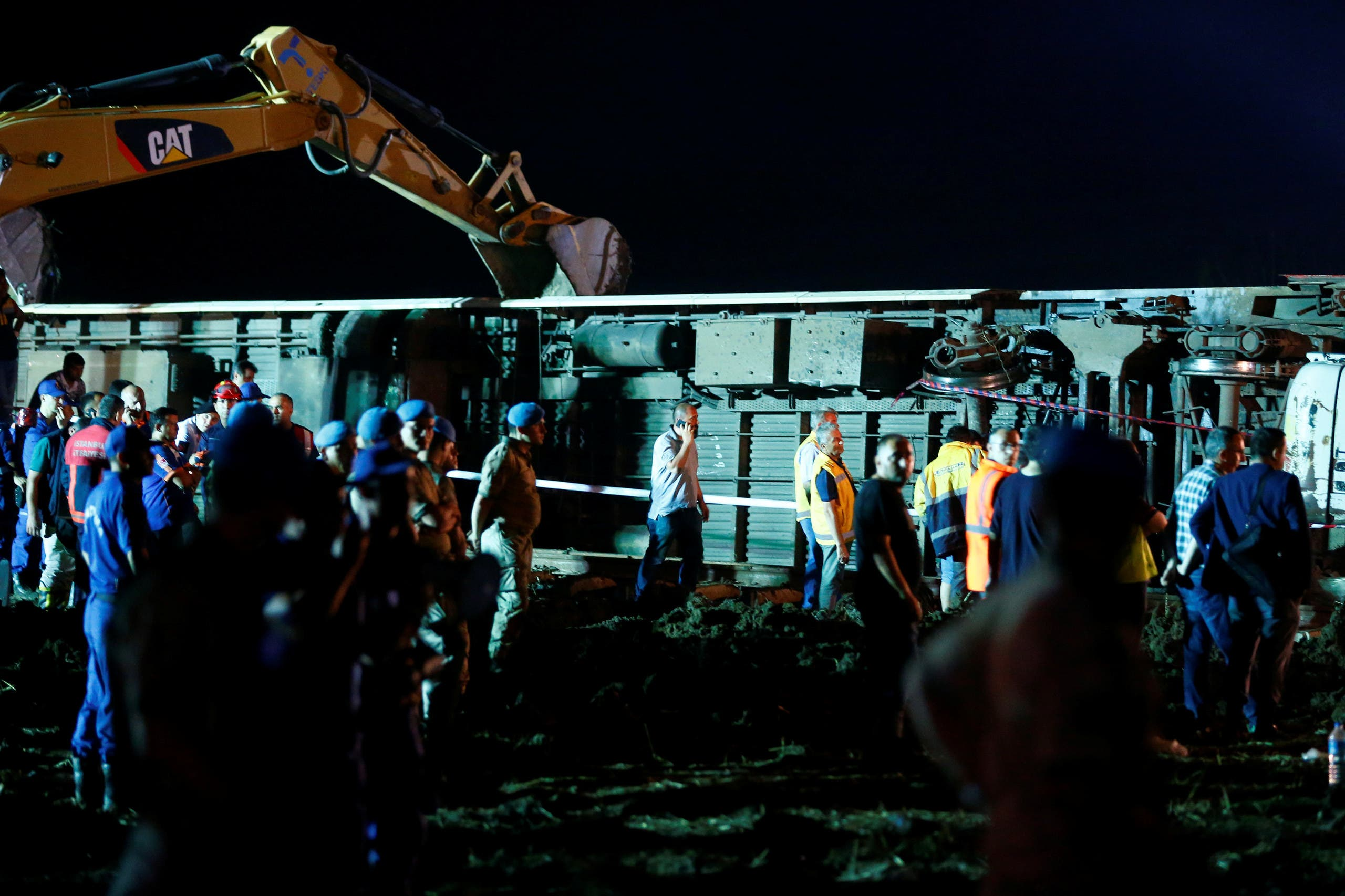 Rescue workers and paramedics work at the site of a train derailment near Corlu in Tekirdag province, Turkey, July 9, 2018. REUTERS