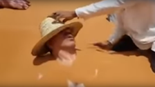 WATCH: Video of Moroccan minister being buried in hot sand goes viral