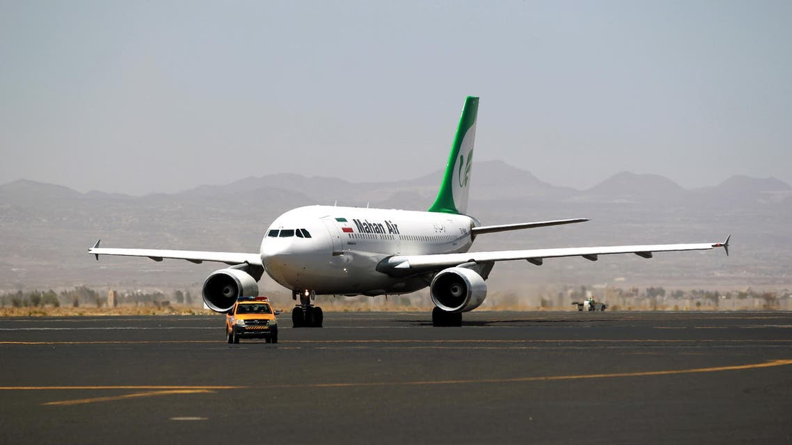 """An airplane of Mahan Air sits at the tarmac after landing at Sanaa International Airport in the Yemeni capital on March 1, 2015 a day after officials from the Shiite militia-controlled city signed an aviation agreement with Tehran. Western-backed President Abedrabbo Mansour Hadi, who fled last weekend an effective house arrest by the Huthis in Sanaa, slammed the agreement as """"illegal,"""" according to an aide. AFP PHOTO / MOHAMMED HUWAIS"""