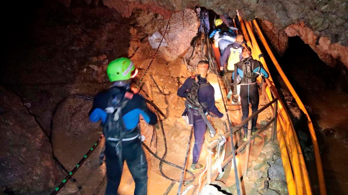 In this undated photo released by Royal Thai Navy on Saturday, July 7, 2018, Thai rescue team members walk inside a cave. (AP)