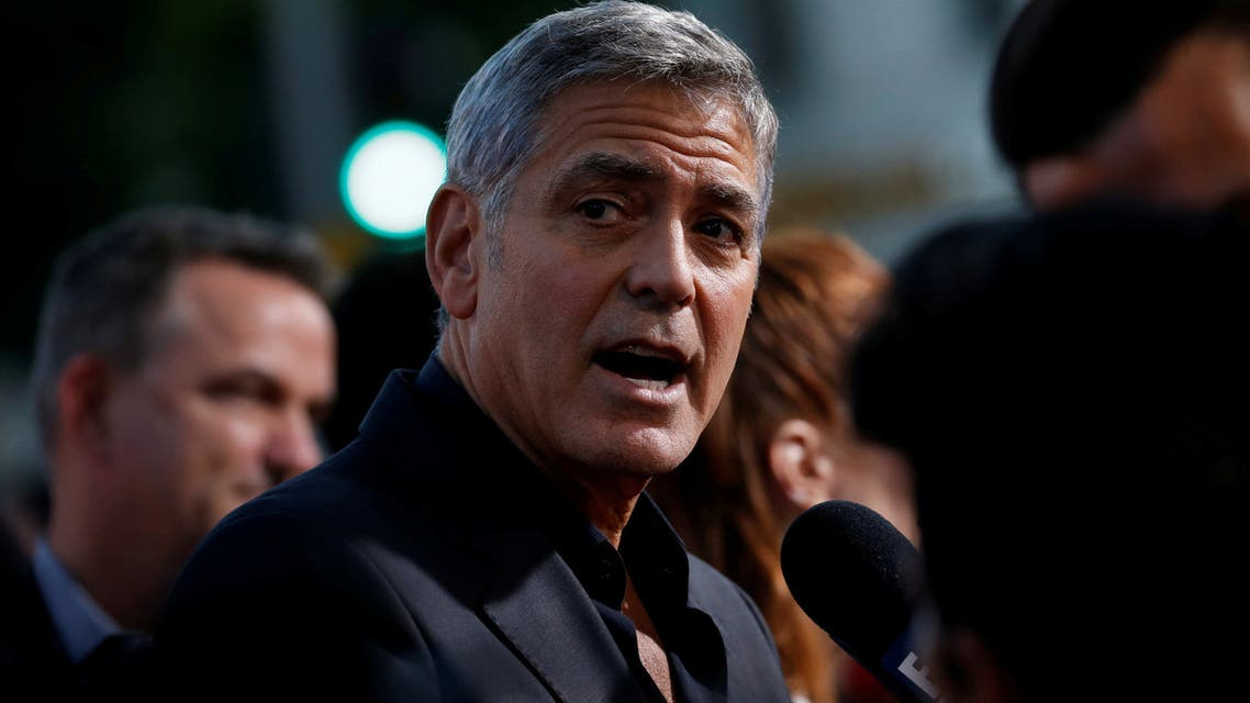 "FILE PHOTO: Director George Clooney is interviewed at the premiere for ""Suburbicon"" in Los Angeles, California, U.S., October 22, 2017. REUTERS/Mario Anzuoni/File Photo"