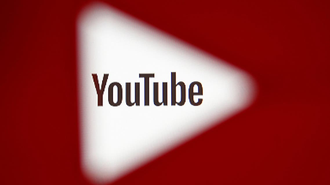 A 3D-printed YouTube icon is seen in front of a displayed YouTube logo in this illustration taken October 25, 2017. (Reuters)