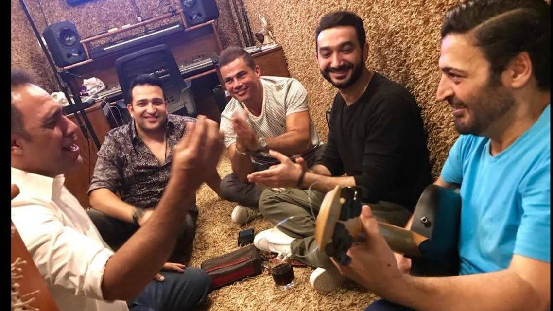 عمرو دياب وفريق ألبومه الجديد