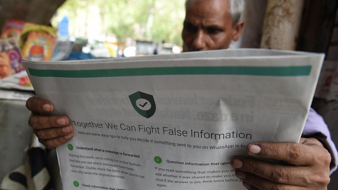 An Indian newspaper with a full back page advertisement from WhatsApp intended to counter fake information, in New Delhi on July 10, 2018. (AFP)