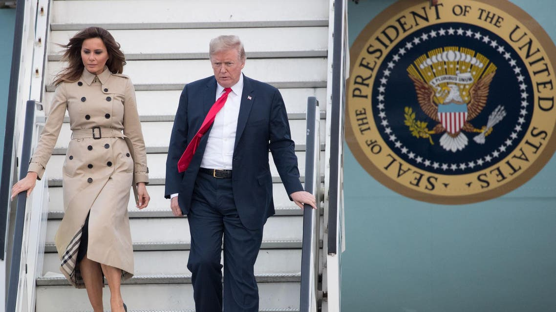 US President Donald Trump (R) and US First Lady Melania Trump disembark from Air Force One as they arrive at Melsbroek Air Base in Haachtsesteenweg on July 10, 2018. US President Donald Trump has arrived in Brussels on the eve of a tense NATO summit where he is set to clash with allies over defence spending. Trump arrived on Air Force One. (AFP)